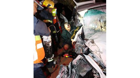 Trapped driver freed from twisted wreck