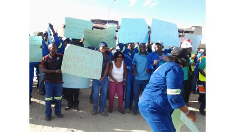 Workers turn up the heat