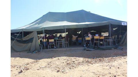 Tent classrooms still common