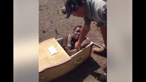 White men charged with shoving black man into coffin