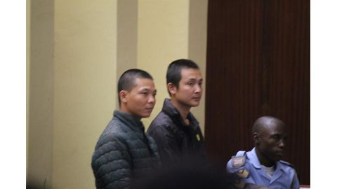 Chinese murder suspects back in court