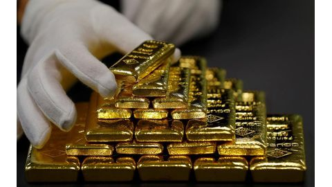 Gold slumps to 18-month low