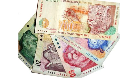 Rand firms slightly