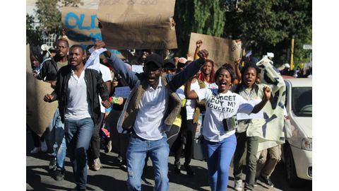Furious Cota students march
