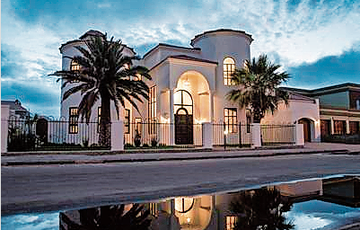 An Elegant address is yours when you move into this stunning Mediterranean style home.