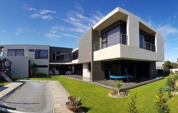 Architect designed materpiece home in sought after position walk in distance from Lagoon