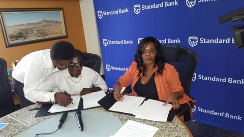 Standard Bank and Shikongo sign house contract