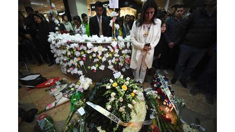 Colombia hunts 'terrorists' behind deadly mall bombing