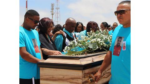 Prinsloo, Pitt laid to rest amid silent protest